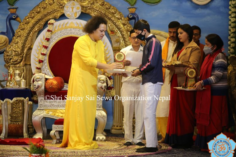Swami graced SEE 4th batch students with a trophy and certificate for passing the SEE 2076